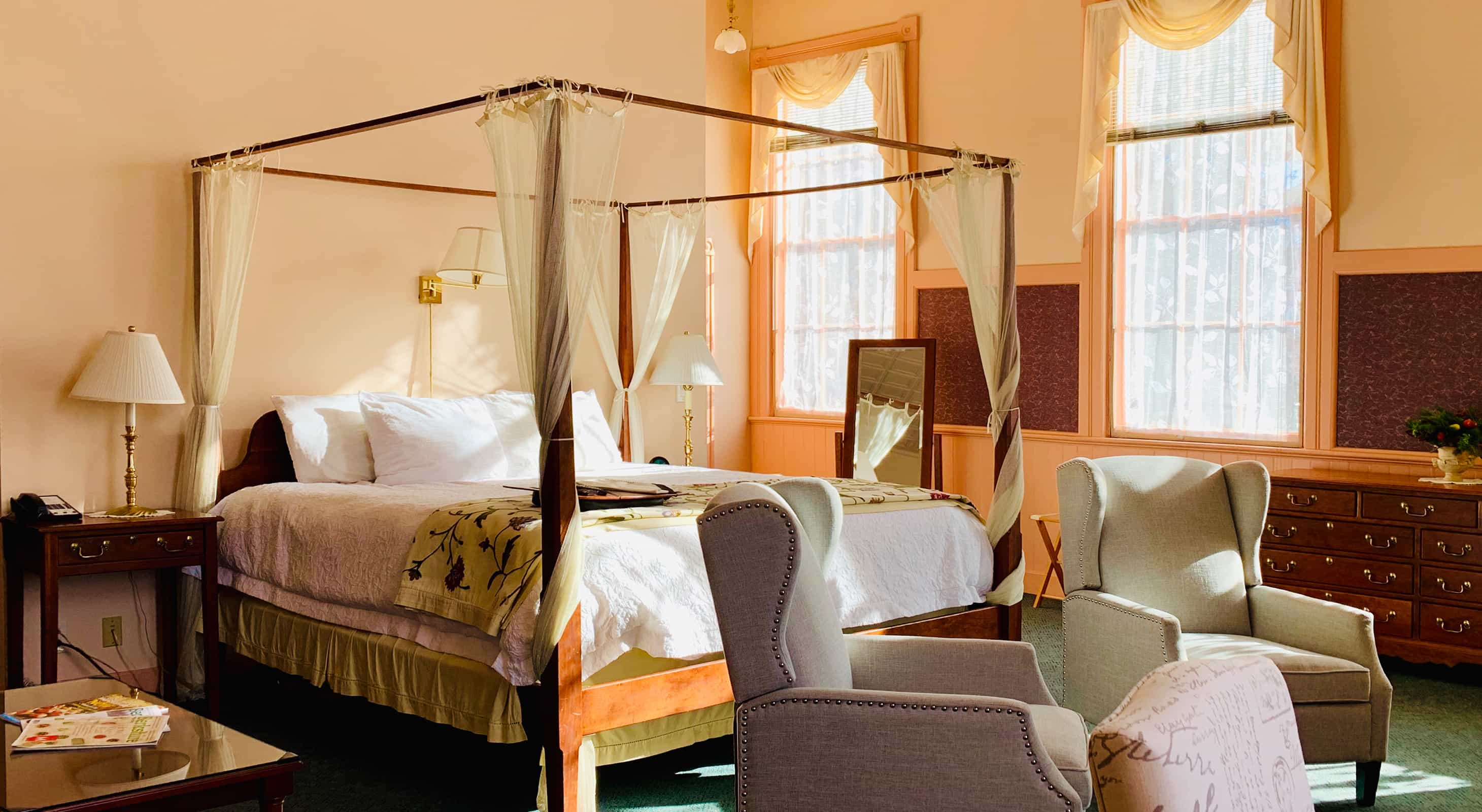 Sunny bed and chairs in the La Chambre room at a Berkshires Bed and Breakfast