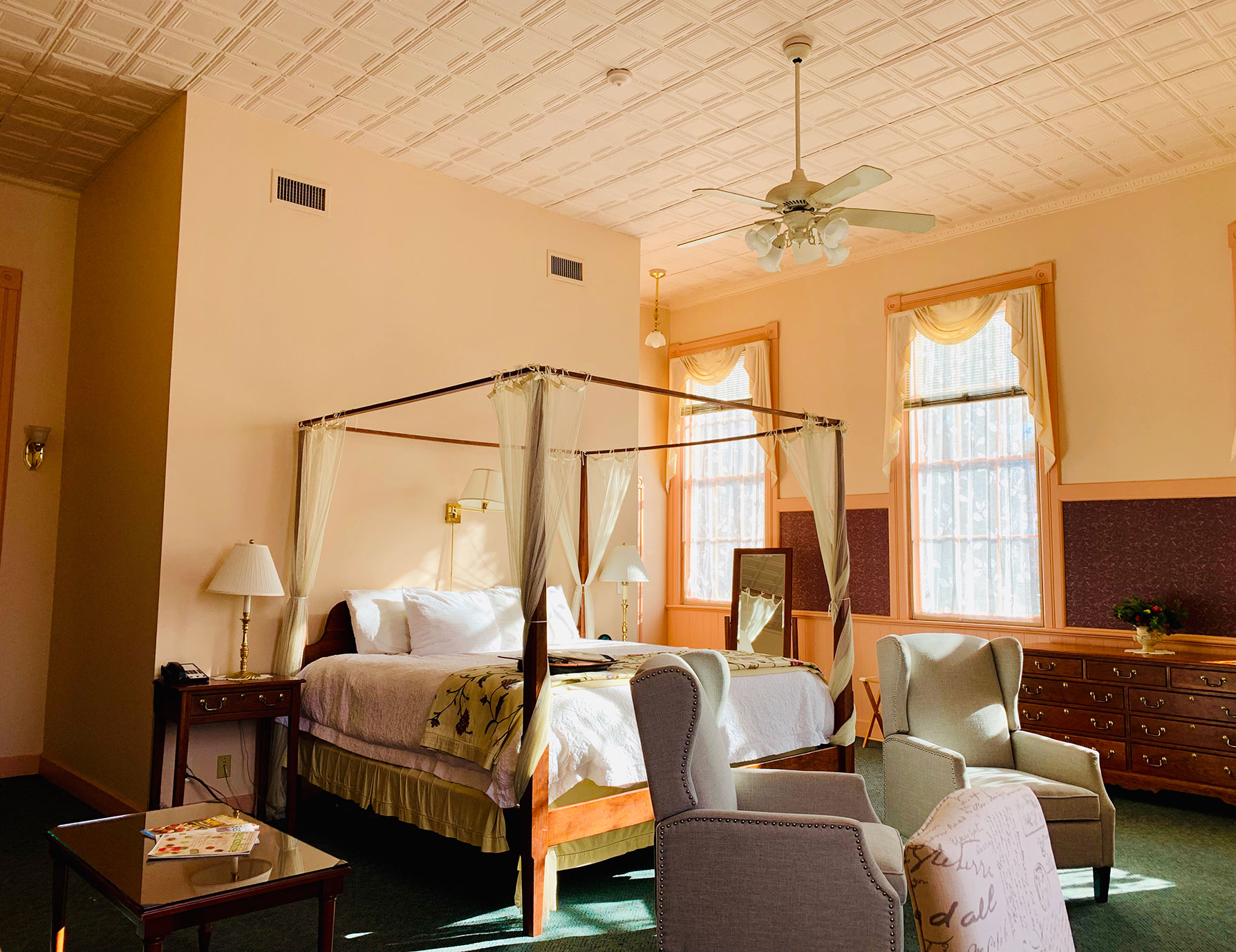 Sunny bed and chairs in the La Chambre room - Lenox Bed and Breakfast