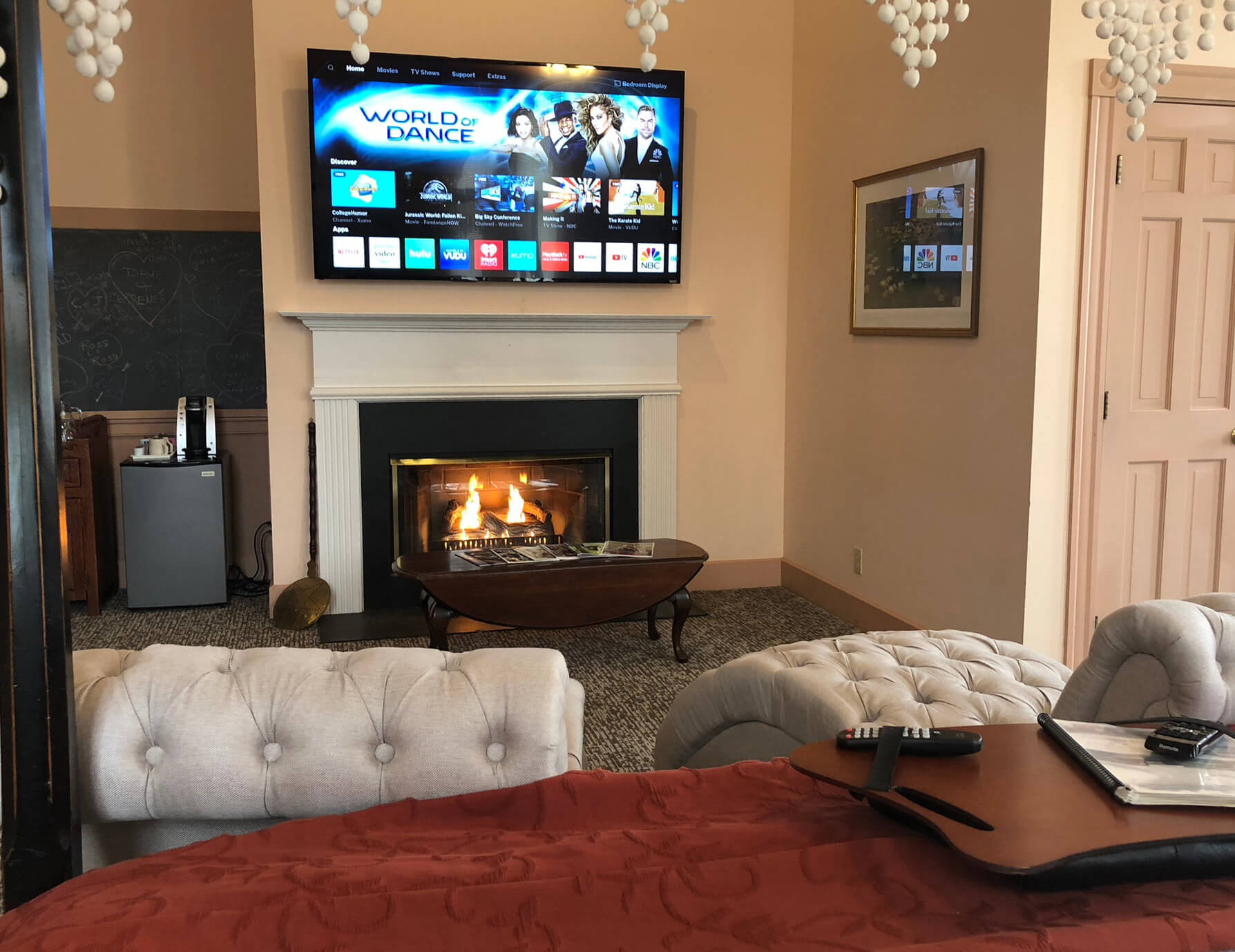 Le Lycee room seating area with fireplace and TV - Tanglewood bed and breakfast