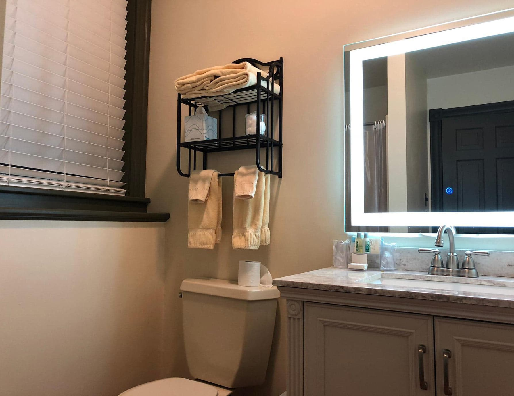 Vanity, lighted mirror, in bathroom of Smallest Room in the Berkshires
