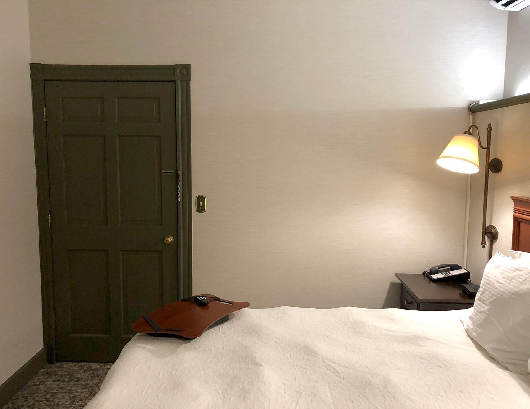 Bed, green door, bedside lamp - Bed and Breakfast in the Berkshires