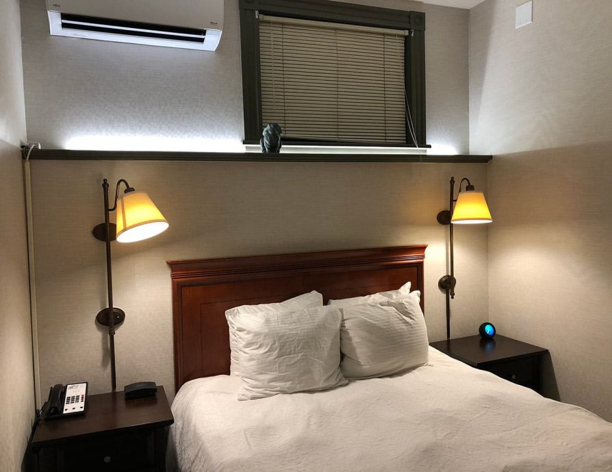 Bed with night tables and lamps in the Smallest Room in the Berkshires