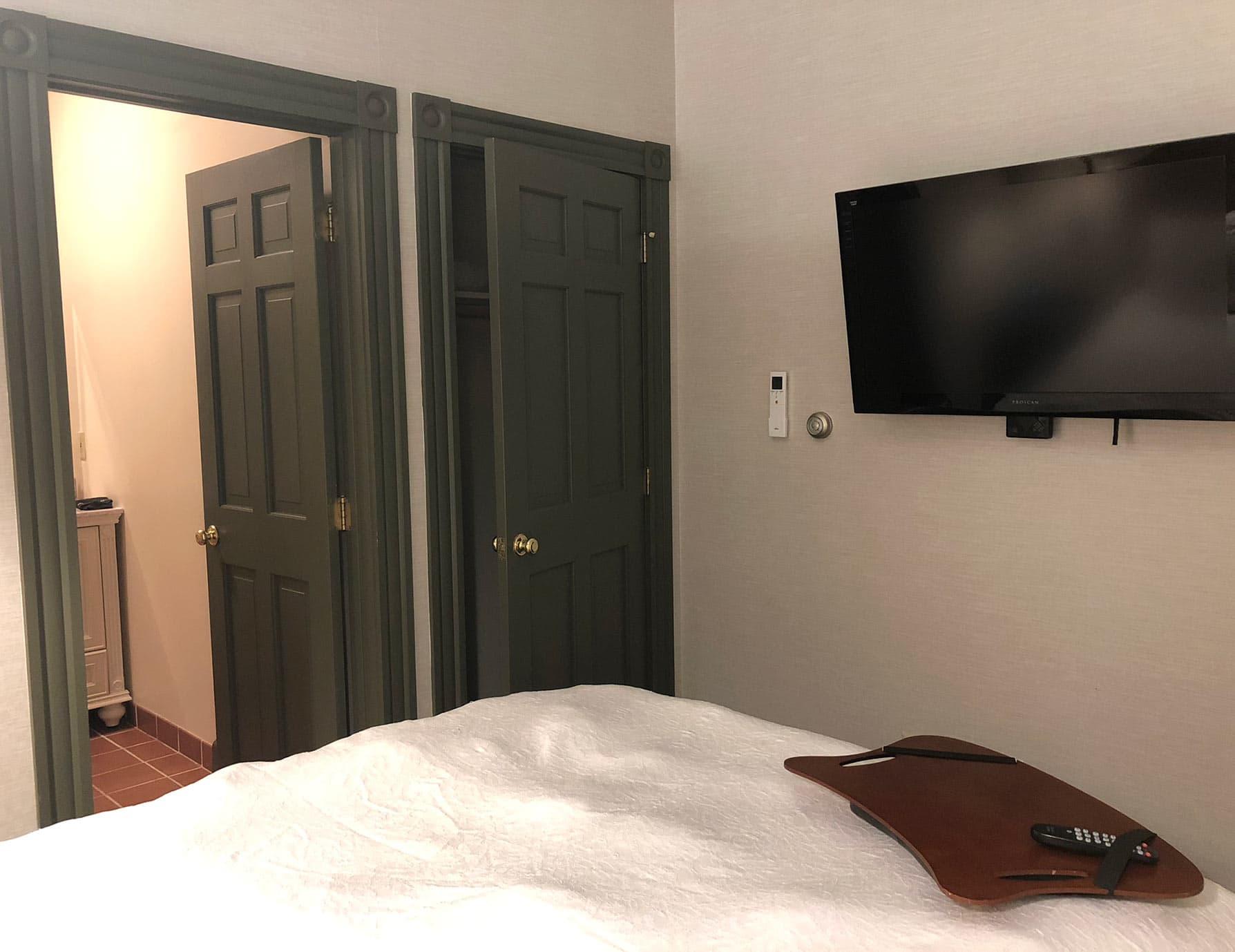 Bed, and TV in Smallest Room in Berkshires - Berkshires Inn