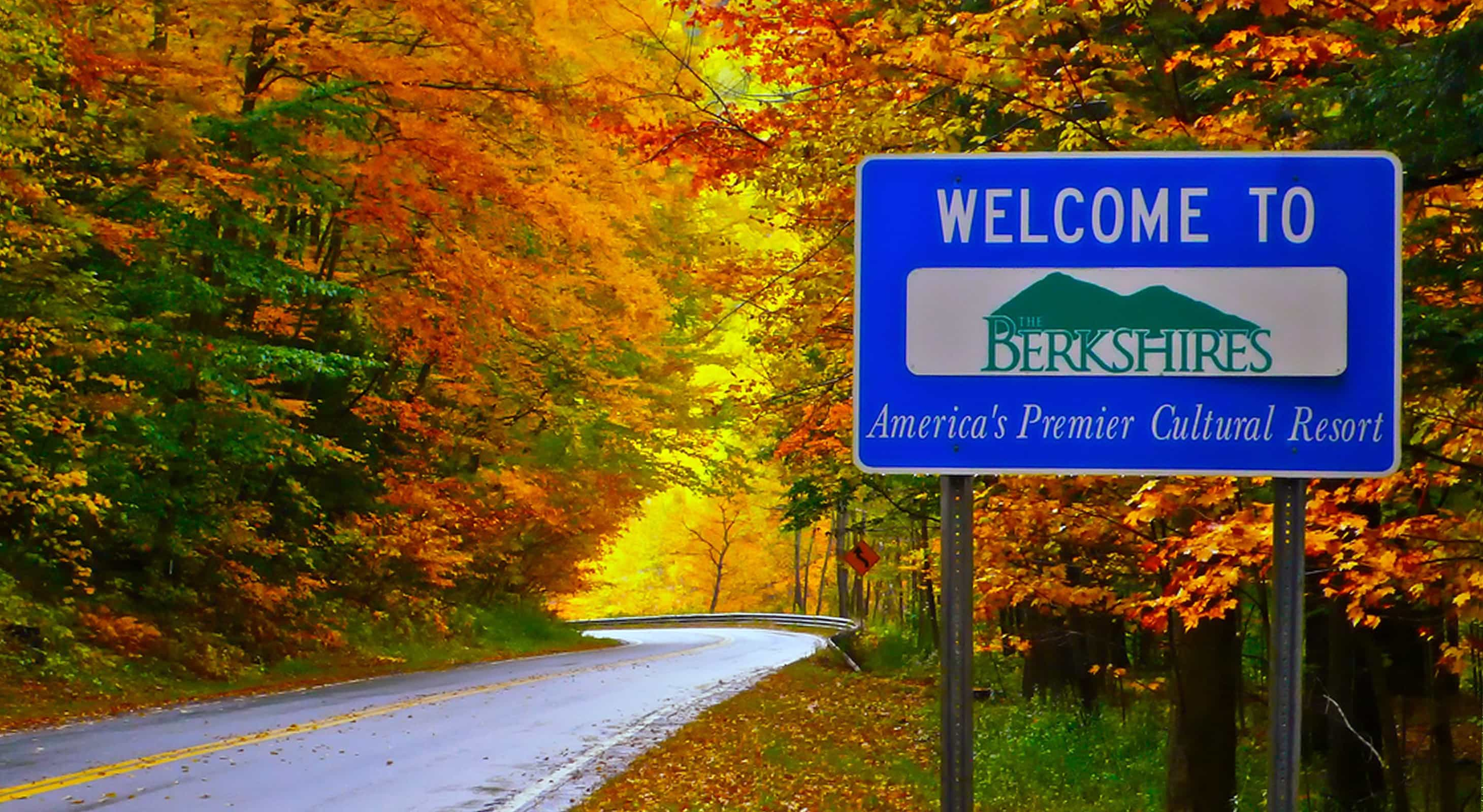 Road with Fall Foliage and Welcome Sign