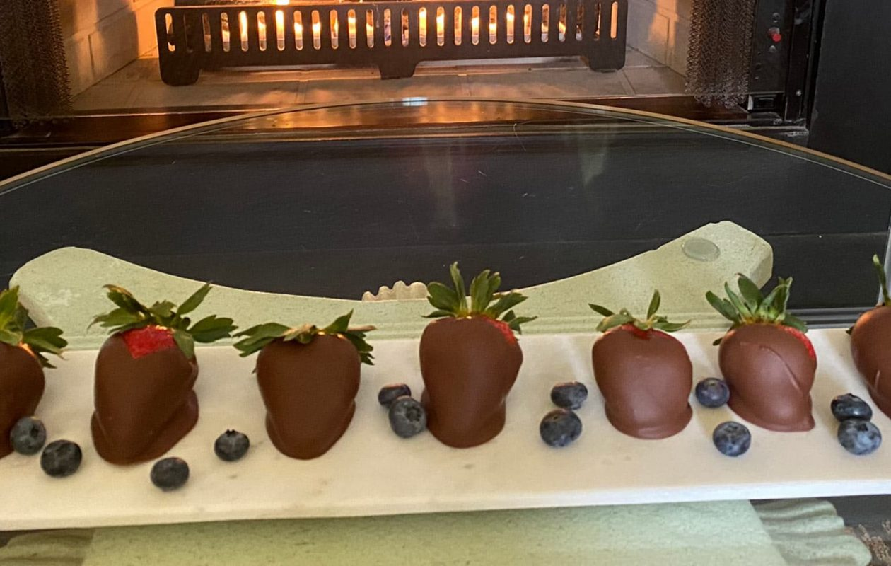 Chocolate Covered Strawberries in front of Fireplace