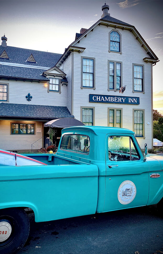 inn and vintage turquoise truck at a Lenox area B&B